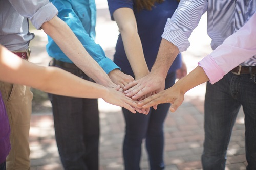 Putting Hands Together During a Teambuilding
