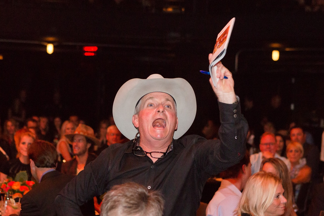 Cowboy Auctioneer ringman at a fundraising event