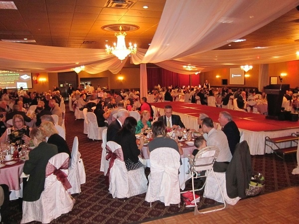 Seated Dinner During A Live Auction Charity Gala