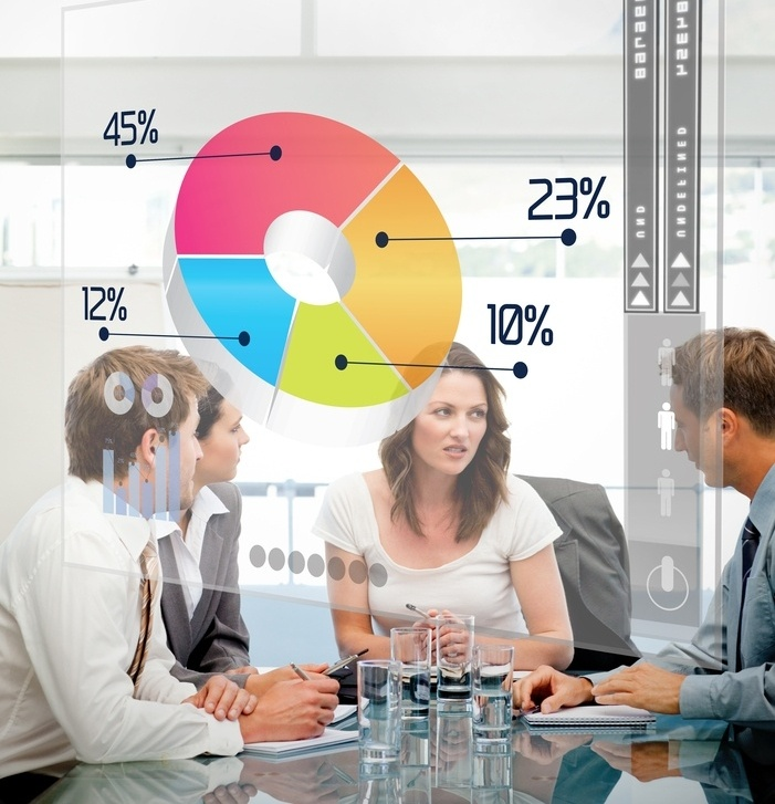 Business workers using colorful pie chart interface in a meeting-239943-edited.jpeg