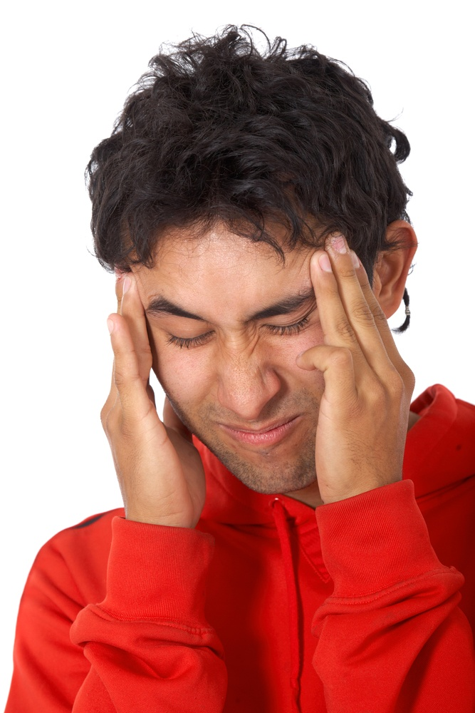 casual man with a headache isolated over a white background