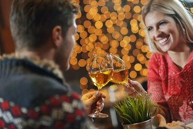 romantic evening date in restaurant  happy young couple with wine glass tea and cake