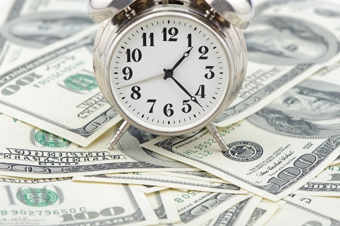 clock on pile of money sm.jpg